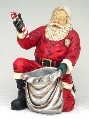 Weihnachtsmann kniend