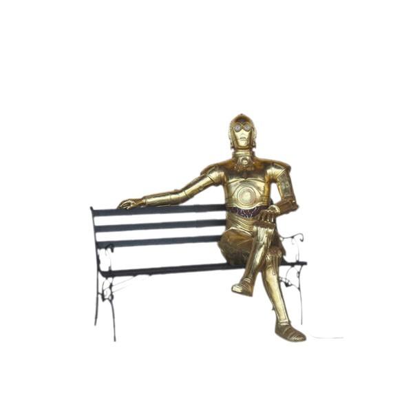 goldener Android sitzend