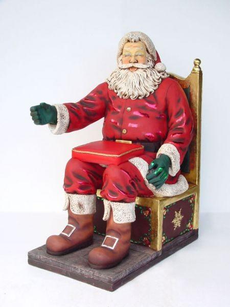 Weihnachtsmann auf Thron mit Kissen