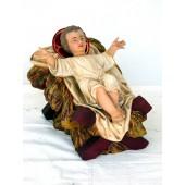 mittelgroßes liegendes Jesuskind in Krippe