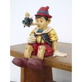 Pinocchio weinend ohne Käfig