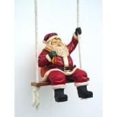 Weihnachtsmann auf Schaukel