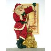 Weihnachtsmann am Fenster stehend