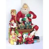 Weihnachtsmann beim Basteln