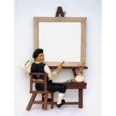 Maler mit Bilderrahmen als Spiegel