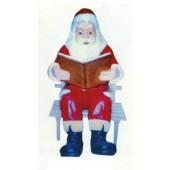 Weihnachtsmann sitzend auf Bank mit Buch
