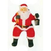 sitzender Weihnachtsmann mit Laterne klein
