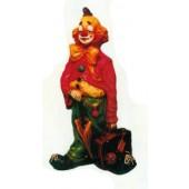 trauriger Clown klein mit offenem Koffer