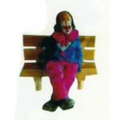 sitzender Clown klein auf Bank