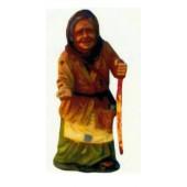alte Frau mit Stock bettelt