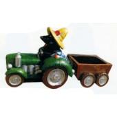 Maulwurfgärtner im Traktor mit Anhänger