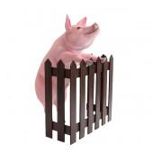 Rosa Schwein stehend am Zaun