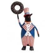 Pinguin amerika mit braunem Donut