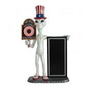 Alien amerika mit Donut auf Tafel und Angebotstafel