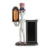 Alien mit Hotdog auf Tafel und Angebotstafel
