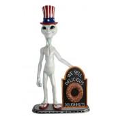 Alien amerika mit Donut auf Angebotstafel