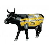Kuh schwarz mit Taxi