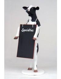 Kuh stehend mit Angebotstafel