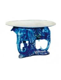 Glastisch mit Elefantenköpfen
