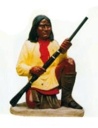 amerikanische Ureinwohnerin mit Schusswaffe sitzend