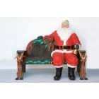 sitzender lebensgroßer Weihnachtsmann mit Glocke auf Weihnachtsbank als SET
