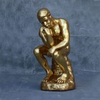 Der Denker in Gold metallic