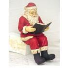 Weihnachtsmann Buch lesend