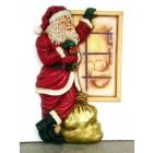 Weihnachtsmann am Fenster stehend klein