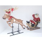 Lustiger Rentierschlitten mit Weihnachtsmann
