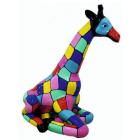 Giraffe sitzend bunt gefleckt